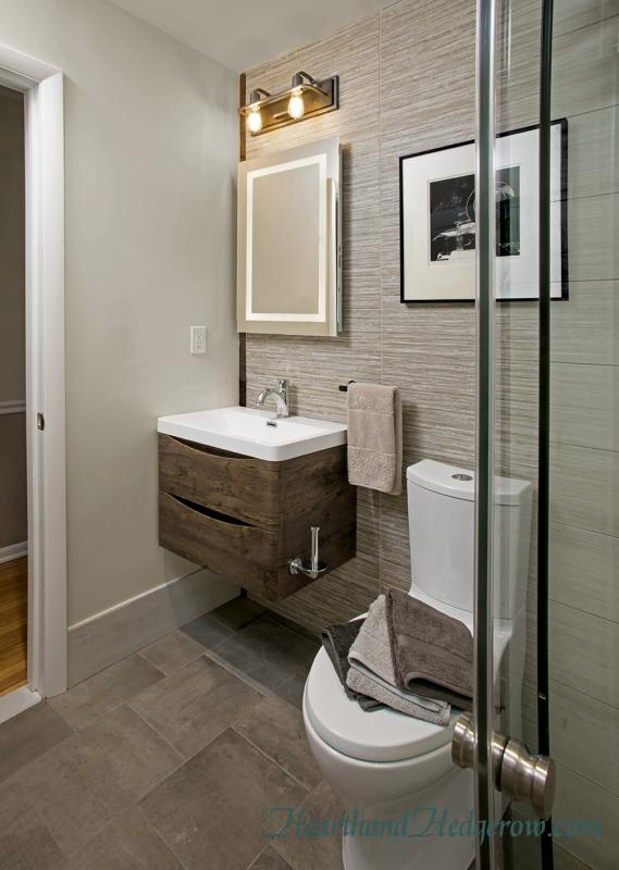 Wall Hung Vanity and Back Lit Mirror in a Modern Bath