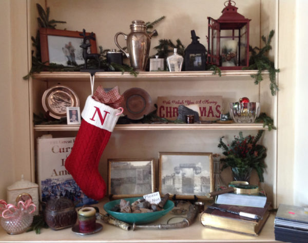 Bookshelves are a perfect place to display holiday decor