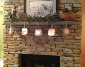 Holiday decor for fireplace mantel. Fresh greens, a simple craft project and a few wintry decorations create a casual, rustic display.