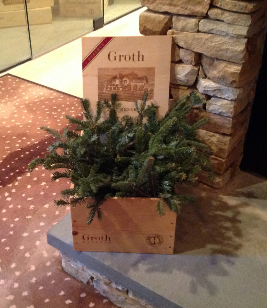 fresh pine in a pine box with a vintner's label sitting on the hearth